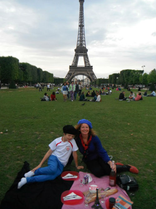 Exploramum and her son enjoying a picnic at the Eiffel Tower on their world travels