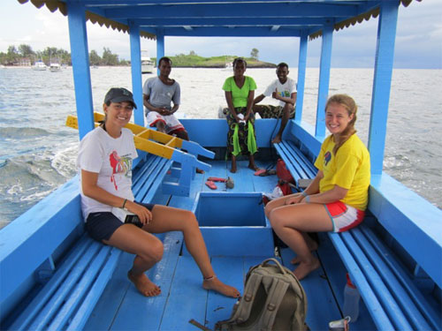 Volunteer and locals on a boat - Helping Kenya