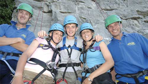 Career breakers teaching kids rock-climbing (image: PGL)