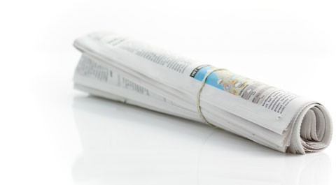 A rolled up newspaper