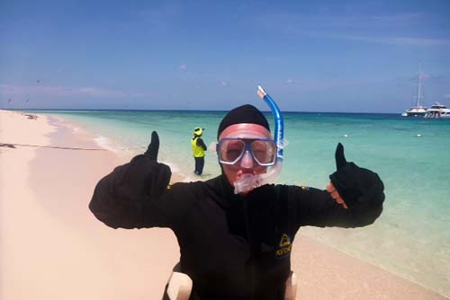 Sally on her career break, getting snorkelled up for a swim on the Great Barrier Reef, Australia