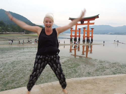Sally in front of the Tori Gate, Mijima Island, Japan