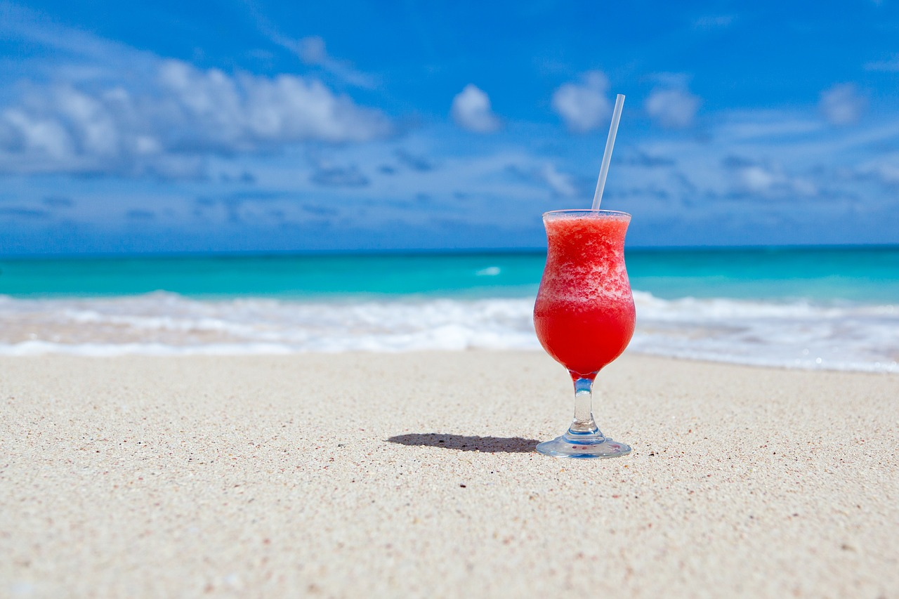 Red cocktail on beach - image from pixabay