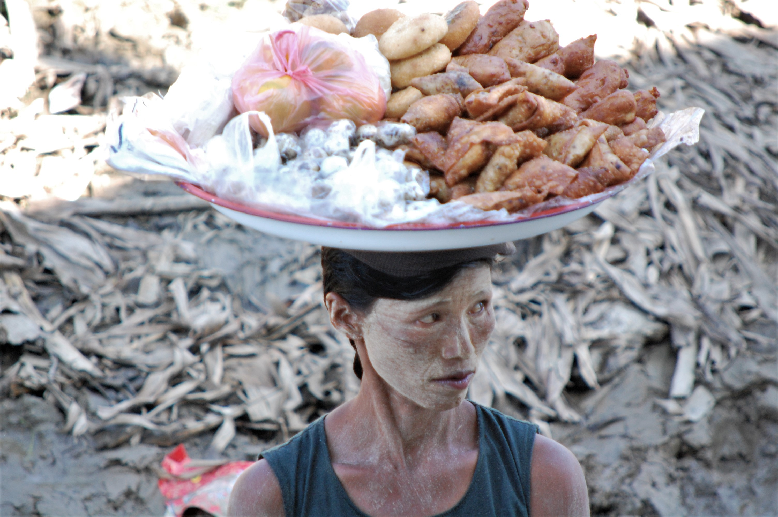 Market trader with food on head - Matthew Lightfoot
