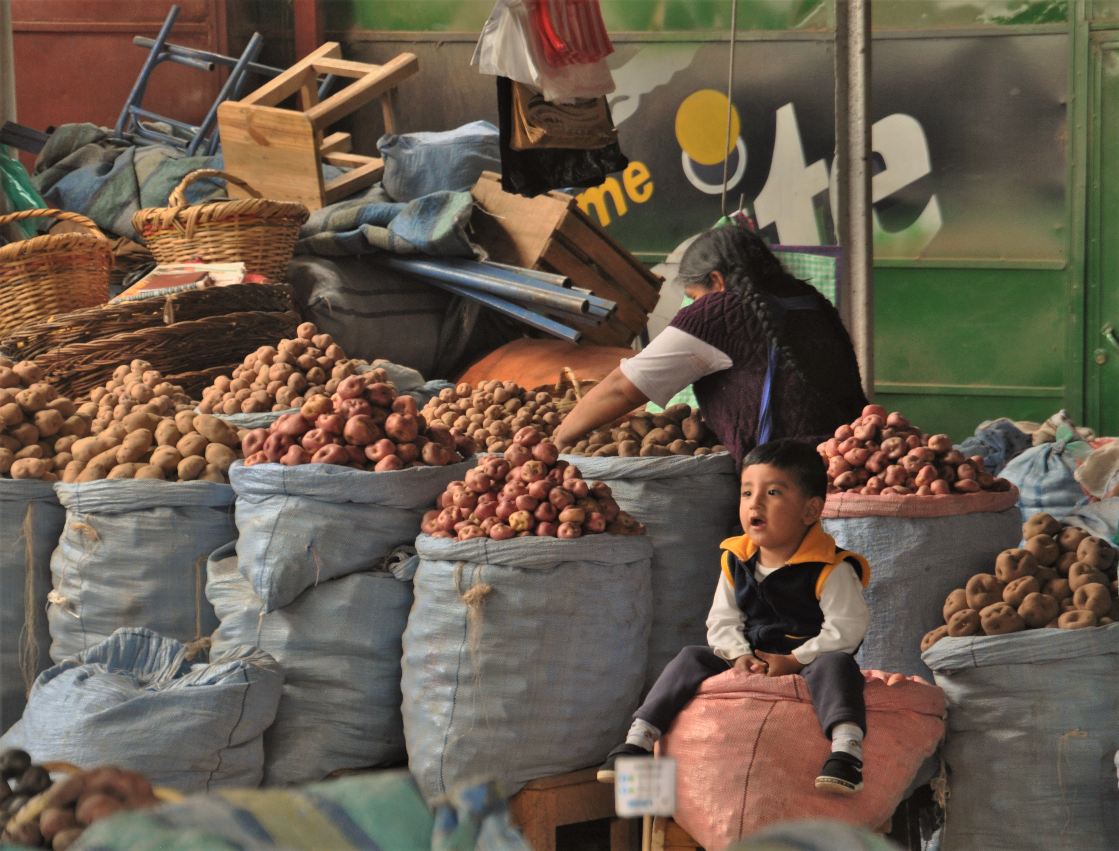 Busy market with potatoes - Matthew Lightfoot