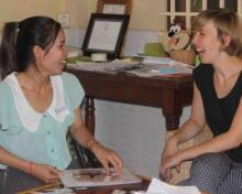 Volunteer laughing with local teacher Teaching and Curriculum Development in Cambodia